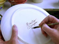 Each piece of HB Henriot Quimper pottery is signed on the back by the artist prior to the firing.